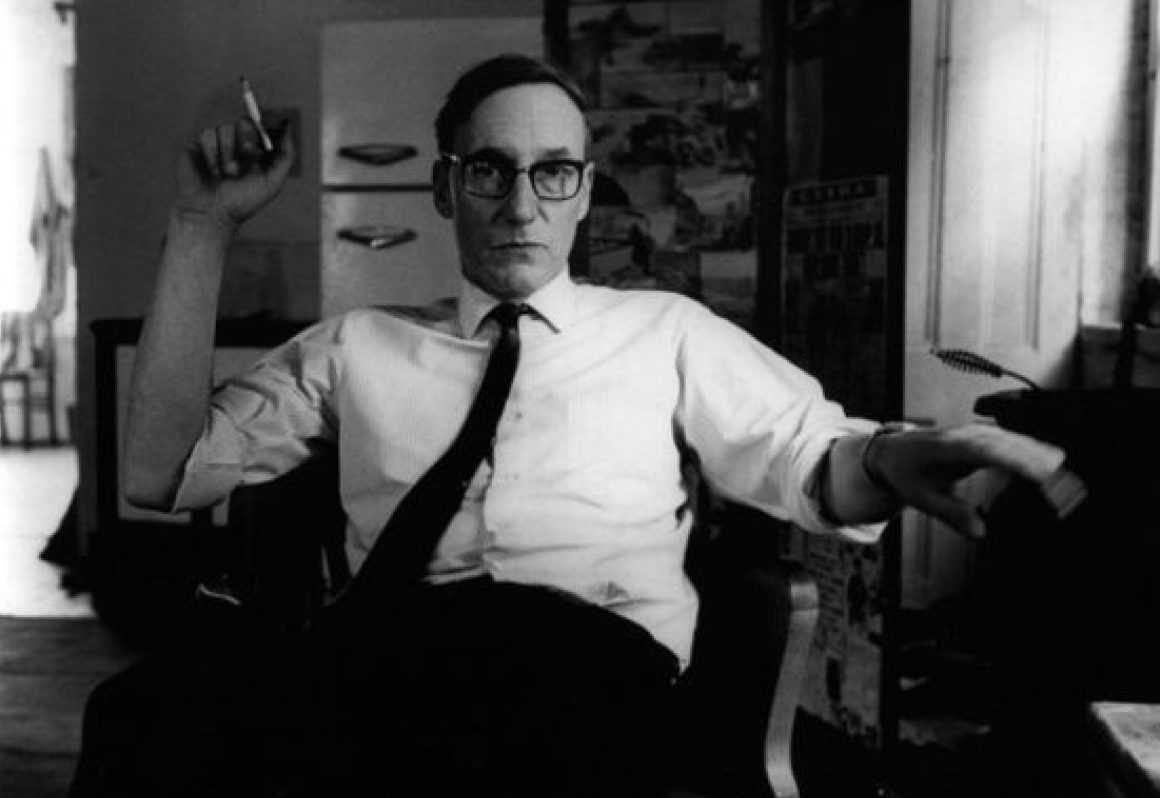 William S. Burroughs in chair